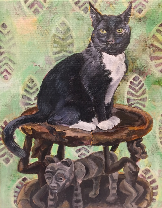 Tuxedo cat on African stool